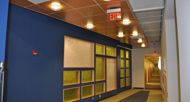 3000 sf high-end renovation of an occupied office space, including custom millwork and 3-Form custom glass walls